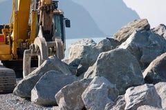 Mechanical grab building sea defenses Royalty Free Stock Photos