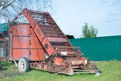 Mechanical hay loader. Outdoor, russian village Royalty Free Stock Images