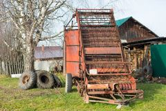 Mechanical hay loader. Outdoor, russian village Royalty Free Stock Photography