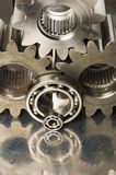 Mechanical idea is brownish. Gears, cogs and ball-bearings in brownish tint Royalty Free Stock Images