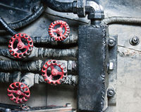 Mechanical industrial grunge background. Grunge background with mechanical workings, pipes, and red knobs Stock Images