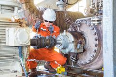 Offshore oil and gas industry maintenance activities. Mechanical inspector inspection and re-alignment oil pump centrifugal type and electric motor. Offshore stock images