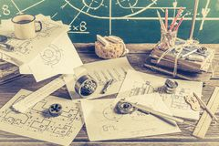 Mechanical Laboratory in School on green chalkboard background. On old table stock photo