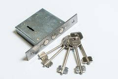 Mechanical lock with a key against white background. Armored door Royalty Free Stock Photo