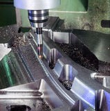 Mechanical Manufacturing. A milling machine works on a steel particular Stock Photo