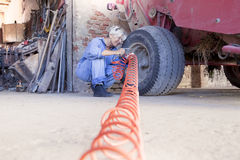 Mechanical mature female inflates the tire Stock Image