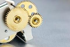 Mechanical metal brass gearwheels. scoreboard mechanism. Stock Images