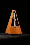 Mechanical metronome with pendulum swing Royalty Free Stock Photo
