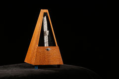 Mechanical metronome with pendulum swing Stock Images