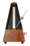 Mechanical Musicial Metronome. Wooden windup music metronome on white background Royalty Free Stock Photos
