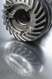 Mechanical-part reflection. Gear-wheel with oil and mirror-image in aluminum Stock Photo