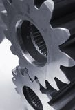 Mechanical parts in black/white. Two gears, cogs, against aluminum in black/white Stock Photos