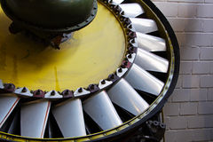 Mechanical parts of the old turbine engine. Against wall Royalty Free Stock Photo