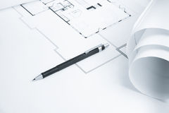 Mechanical Pencil on Blue Print. With sharp focus on tip of pencil lead and paper roll stock photography