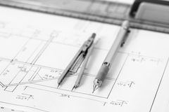 Mechanical pencil and divider on technical drawing Royalty Free Stock Photography