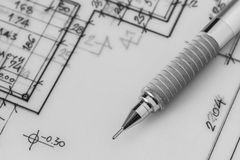 Mechanical pencil on drawing. Photo of mechanical pencil on an architecture drawing Royalty Free Stock Photos