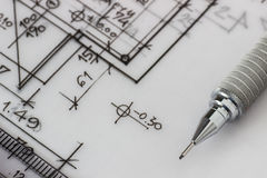 Mechanical pencil on drawing. Photo of mechanical pencil on technical drawing Royalty Free Stock Photos