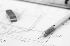 Mechanical pencil and eraser on technical drawing. Black and white photo of mechanical pencil and eraser on technical drawing Royalty Free Stock Images