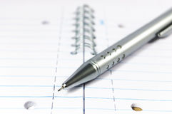 Mechanical pencil on a notepad. Metal mechanical pencil on a spiral-bound notepad Stock Images