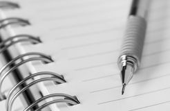 Mechanical pencil on notepad. Royalty Free Stock Image
