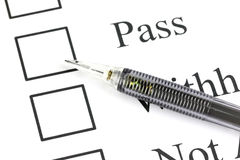 Mechanical pencil point to Checkbox in Pass text. Royalty Free Stock Photo