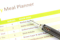 Mechanical pencil point to Meal Planner graph. Stock Image