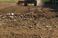 Mechanical Rake to Gather Stones of the the land. Rake machine cleanser stones, pulled by a tractor, separating or removing the stones of the land royalty free stock photo