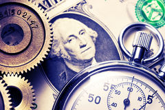 Mechanical ratchets, stopwatch and dollar Royalty Free Stock Photos