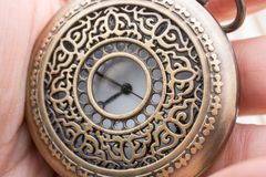 Mechanical retro styled pocket watch. In view Royalty Free Stock Image