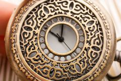 Mechanical retro styled pocket watch. In view Royalty Free Stock Photo