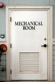 Mechanical room door. On the outside of a building stock photography
