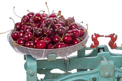 Mechanical scales with a large cherry Stock Image