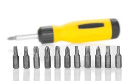 Mechanical screwdriver and set of the heads Stock Photos