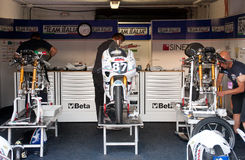 Mechanical set up. ALBACETE, SPAIN - OCT 8:  mechanics preparing three aprilia 125 motorcycles for the Gabrielli Racing italian team, in the set up before the Stock Photo