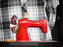 Mechanical sewing machine. Vintage, old, red, mechanical sewing machine stock photography
