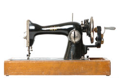 Mechanical sewing machine isol. Old mechanical sewing machine isolated on white background royalty free stock image