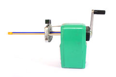 Mechanical sharpener of pencils. On the white background Royalty Free Stock Photo