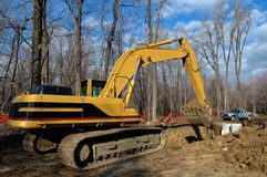 Mechanical shovel in close up unloading earth. At moving works in construction site royalty free stock images