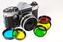 The mechanical SLR and photofilters. The mechanical SLR and set of photofilters Stock Images