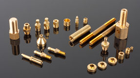 Mechanical spare parts. Set of brass mechanical spare parts royalty free stock photos