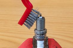 Mechanical spark plug cleaning technology with a metal brush royalty free stock photography