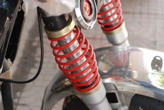 Mechanical spring. Red spring on a motorcycle Royalty Free Stock Photography