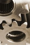 Mechanical steel-ideas. Two cog-wheels in close-up Stock Image