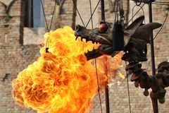 Mechanical steel steampunk-like dragon emit fire Stock Photography
