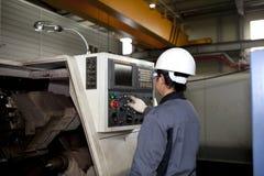 Mechanical technician of cnc machine. Technician worker operating cnc machine center Stock Photos