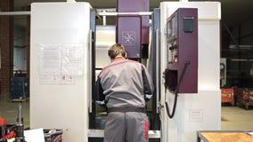 Mechanical technician operative of cnc milling cutting machine center stock footage