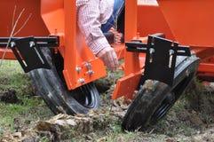 Mechanical Tree Planter. Planting of tree seedlings using mechanical tree planting machine royalty free stock photo