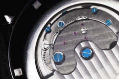 Mechanical watch with automatic winding. Mechanical luxury men wrist watch with automatic winding, close-up fragment of open back side with self-winding Royalty Free Stock Images