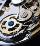 Mechanical watch machinery. Vintage clockwork gears close up macro detail Royalty Free Stock Image