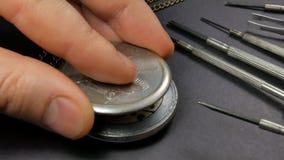 Mechanical watch repair. Watchmaker assembles a watch.  stock video footage